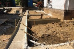 Preparing groundworks to a planned extension in Surrey